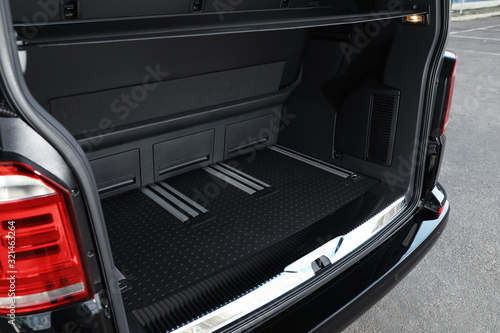 Fotografie, Obraz Modern car with open empty trunk outdoors