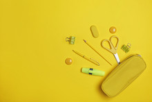 Flat Lay Composition With Pencil Box And Stationery On Yellow Background. Space For Text