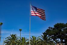USA Flagpole With Blue Sky And...