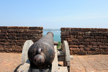 Old Black Cannon Pointing Thro...