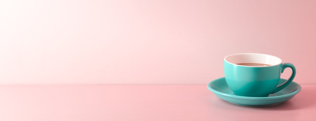 A cup of fresh coffee on pink background