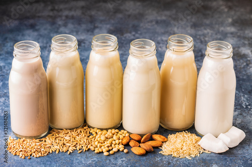 Photo A bottles of alternative  milk and ingredient