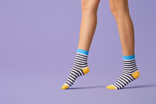 Legs Of Young Woman In Striped...