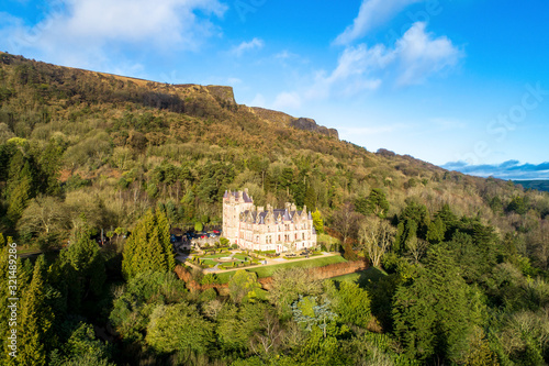Cave Hill Country Park and Belfast castle, built in 19th century. Tourist attraction  in Belfast, Northern Ireland. Aerial view