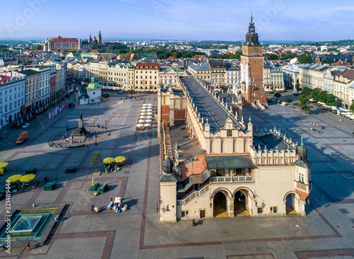 Krakow, Poland. Aerial view of old town, with Main Market Square (Rynek), old drapers' hall (Sukiennice), Mickiewicz statue, St. Adalbert small church and far view of Wawel castle and cathedral