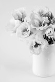 Beauty Eustoma flowers in vase. Black and white photo