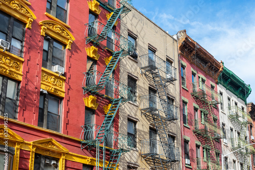 Colorful Old Buildings in Chinatown New York City with Fire Escapes