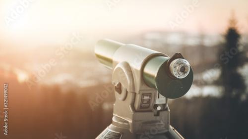 Fototapeta Future and inspiration concept: Tourist binocular, winter landscape and sunshine in blurry background. obraz