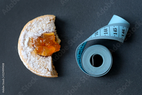 A piece of cake and a centimeter on a black background Canvas Print