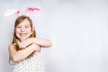 Happy Cute Girl With Bunny Ear...