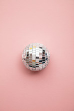 Disco Glitter Mirror Ball On A Pastel Pink Background