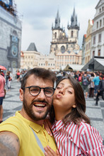 Man And Woman Walking In City Streets On Vacation Tourism And Making Selfie.