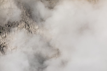 Steam rising from Dragons's Mouth Spring, Yellowstone National Park