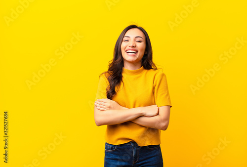 young latin pretty woman looking like a happy, proud and satisfied achiever smil Canvas Print