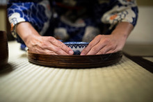 Japan, Hands Of Woman Holding ...