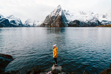 Happy Tourist Standing On A Rock At Hamnoy, Lofoten, Norway