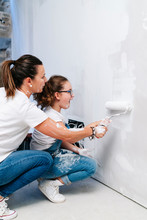 Mother And Daughter Painting A...