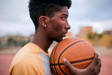 Teenager Holding Basketball