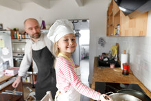 Father And Daughter Cooking In...