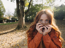 Portrait Of A Redheaded Woman In A Park In Autumn