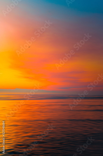 California Coastal Sunset off Highway 1 of the Pacific Ocean, Colorful Sky and Reflection in Santa Cruz