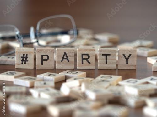 Fototapeta hashtag party concept represented by wooden letter tiles