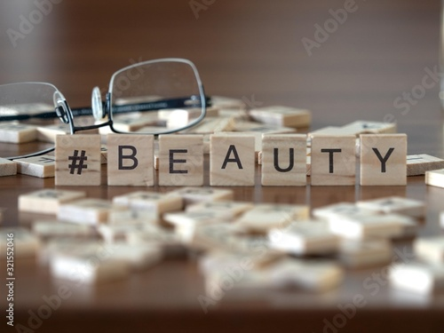 Photo hashtag beauty concept represented by wooden letter tiles