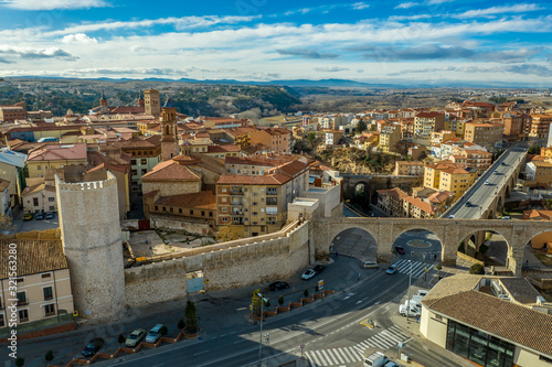 Aerial panoramic view of Teruel Spain with medieval city walls, viaduct, aquaduct and semi circular tower on a sunny winter afternoon