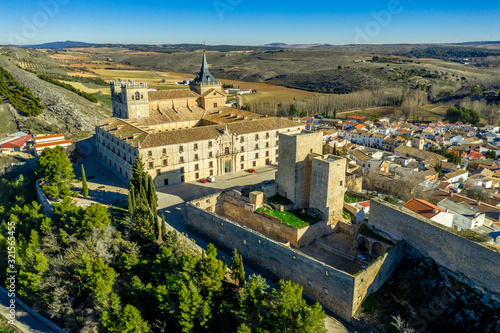 Aerial view of Ucles castle and monastery with two keeps gates and towers encirc Wallpaper Mural
