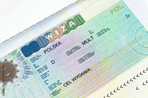 Fragment of Schengen multi entrance Polish visa in passport close-up Canvas-taulu