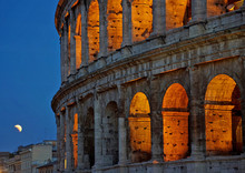"""The Total Lunar Eclipse """"blood Moon"""" Rises Behind The Colosseum In Rome, Italy In July Of 2017."""