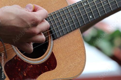 Fotografia, Obraz Hand strumming a guitar