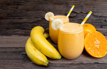 Banana And Orange Smoothies Yellow Colorful Fruit Juice Milkshake Blend Beverage Healthy High Protein The Taste Yummy In Glass,drink To Lose Weight Drink Episode On Wooden Background.