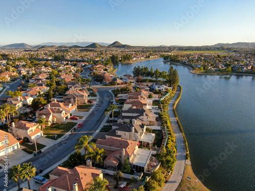 Fototapeta Aerial view of Menifee Lake and neighborhood, residential subdivision vila during sunset. Riverside County, California, United States obraz