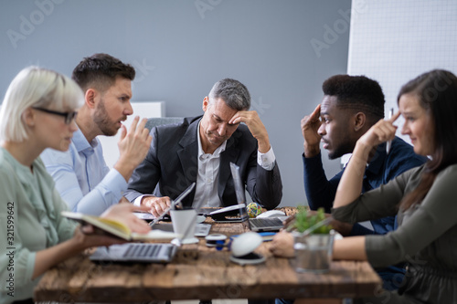 Business People Arguing In Meeting Canvas Print