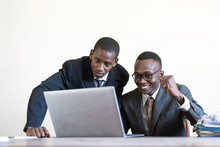 Black Working Men Studying I...