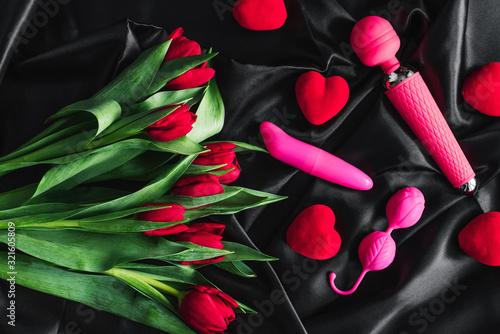 Foto Various sex toys set on a black background