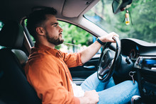 Man In Casual Clothing Driving Car