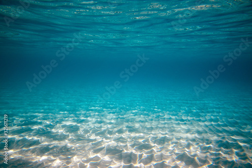 Empty underwater ocean bottom background with copy space