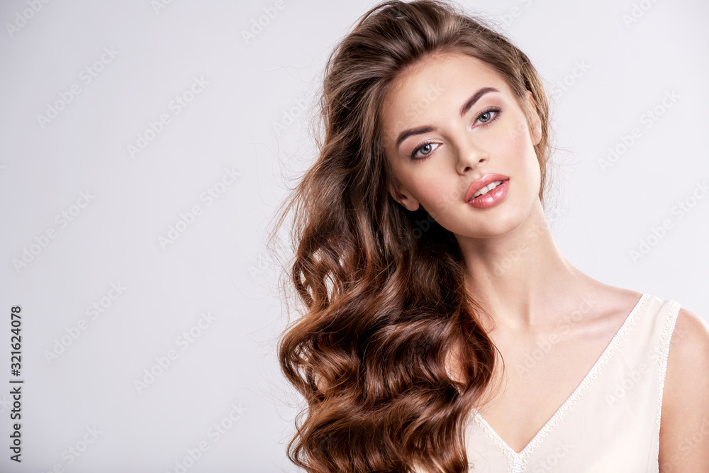 Fototapeta Portrait of a beautiful woman with a long brown hair.