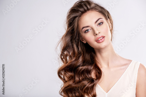 Tablou Canvas Portrait of a beautiful woman with a long brown hair.
