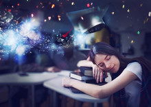Tired Girl Sleeps Over Books And Dreams Of Graduating. Concept Of Graduation And Determination