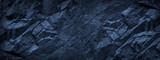 Fototapeta Kamienie - Dark blue grunge background. Deep blue stone background. Toned mountain texture close-up. Banner with copy space for your design. Volumetric rock background.