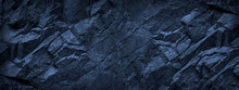 Dark Blue Grunge Background. Deep Blue Stone Background. Toned Mountain Texture Close-up. Banner With Copy Space For Your Design. Volumetric Rock Background.