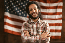 Patriotic American Man Cheerfully Laughs With His Arms Crossed