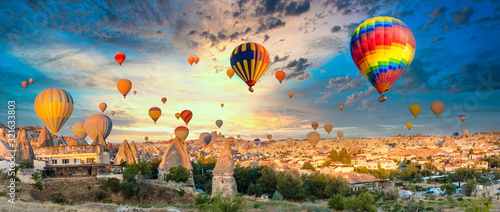 Fotografia, Obraz Colorful hot air balloons flying over at fairy chimneys in Nevsehir, Goreme, Cappadocia Turkey