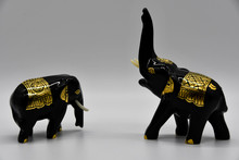 Two Black And Gold Decorated E...