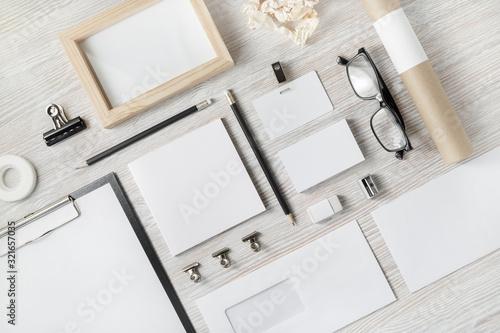 Cuadros en Lienzo Photo of blank stationery set on light wooden background