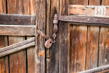 Old Gate With A Rusty Lock. Ba...