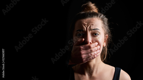 Stressed unhappy crying woman victim in fear suffering from female domestic viol Fotobehang
